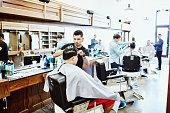 men having hair cut barber shop