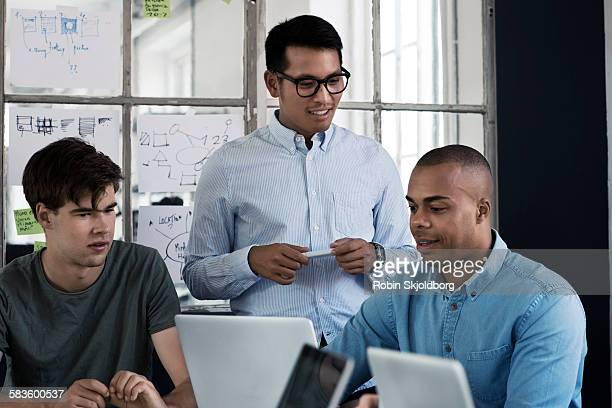men having meeting in creative office - robin skjoldborg stock pictures, royalty-free photos & images