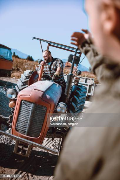 men helping a tractor driver for direction - macedonia country stock pictures, royalty-free photos & images