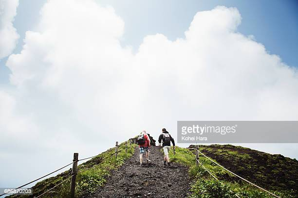 Men hiking a mountain together