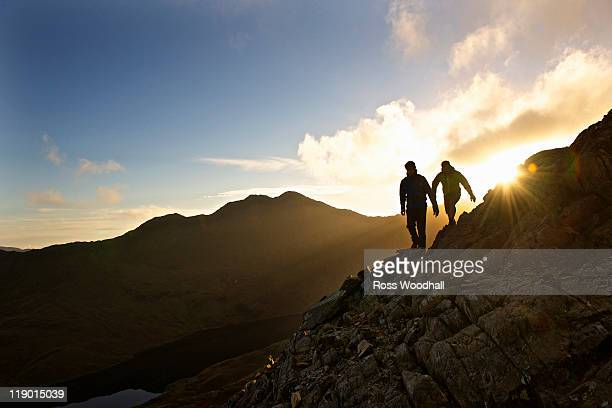 Men hiking on rocky mountainside
