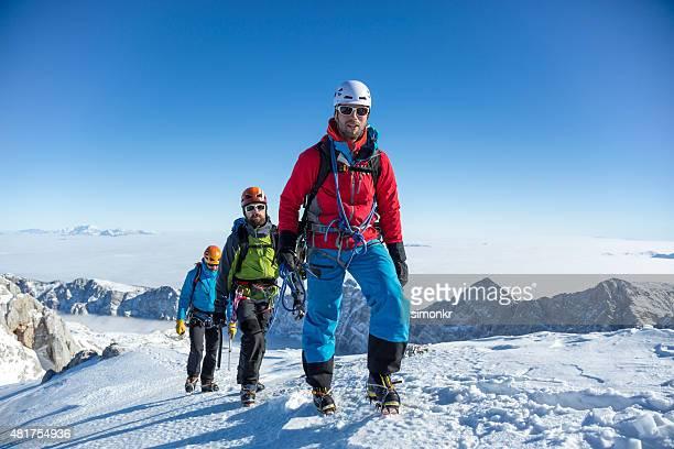 Men hiking on snow covered landscape