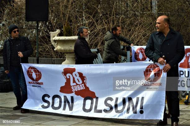 Men hold a banner as an organized group of proIslamic demonstrators makes a statement outside the main courthouse on the 21th anniversary of Turkey's...