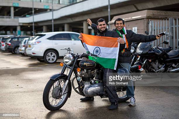 Men hold a flag on a motorbike as crowds begin to arrive at Wembley Stadium to hear Indian Prime Minister Narendra Modi speak during the second day...