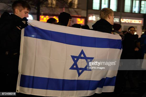 Men holding an Israeli flag during a demonstration for the victims of antisemitism About 100 demonstrators take part in the demonstration for the...