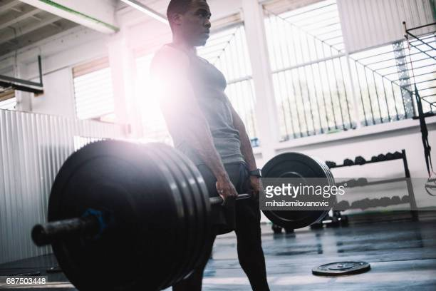 men holding barbell with alot of weights - black male bodybuilders stock photos and pictures