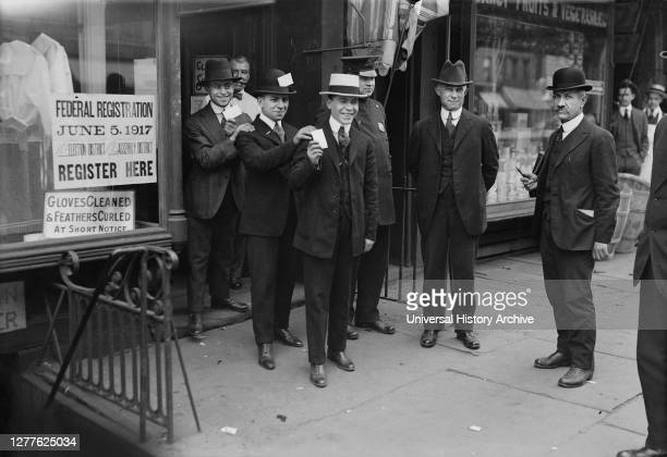 Men holding Draft Cards coming out of Building after registering for the Draft during World War I, New York City, New York, USA, Bain News Service,...