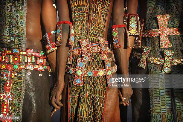 men holding hands wearing tribal designs - indigenous culture stock pictures, royalty-free photos & images