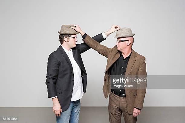 Men holding hats