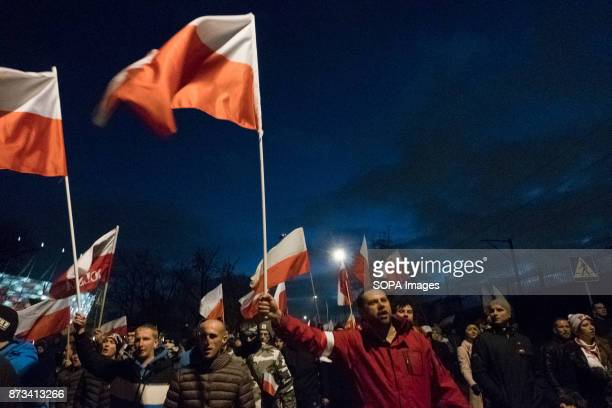 Men holding Polish flags as thousands gather for the annual nationalist march of Poland´s Independency Day Poland's Independence Day is a annual day...