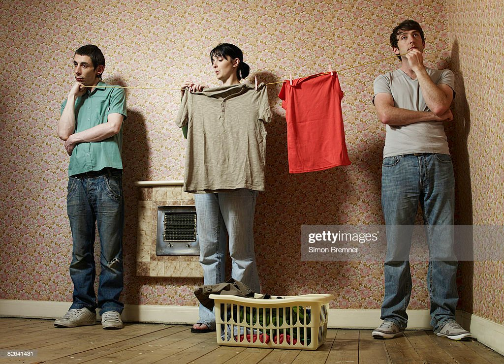 Men holding washing line for woman : ストックフォト
