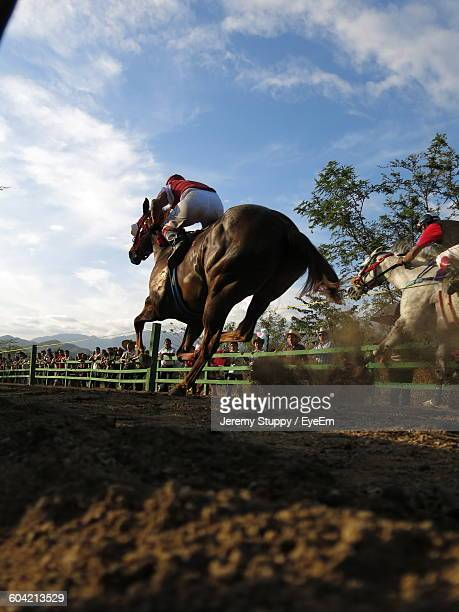Men Horseback Riding In Race Against Sky