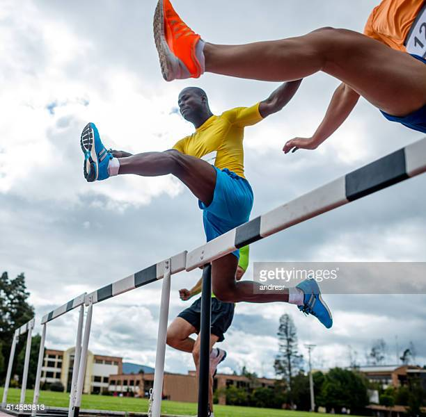 men hurdling - steeplechase track event stock pictures, royalty-free photos & images