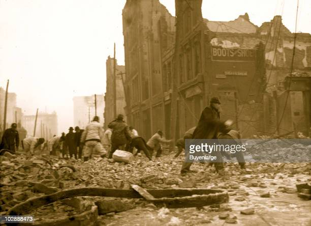 Men hurry on the street as they work to dynamite buildings during the Baltimore fire 1904 The leveling of the buildings by dynamite was a desperate...