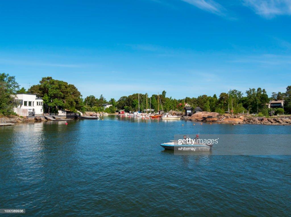 Men in a boat in the Suomenlinna Islands, Finland : Stock Photo