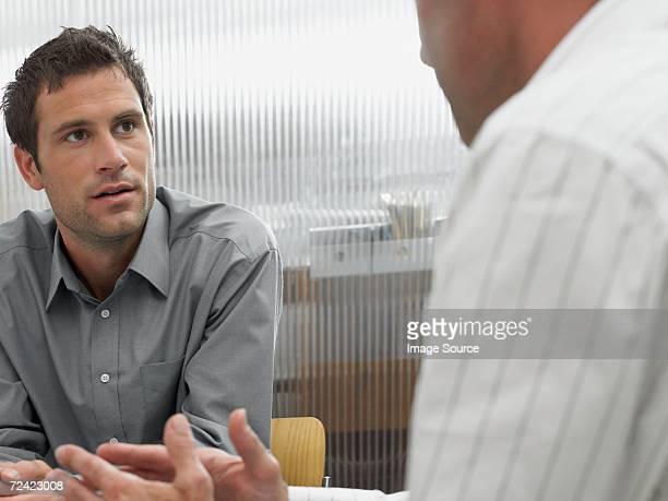 Men in a discussion