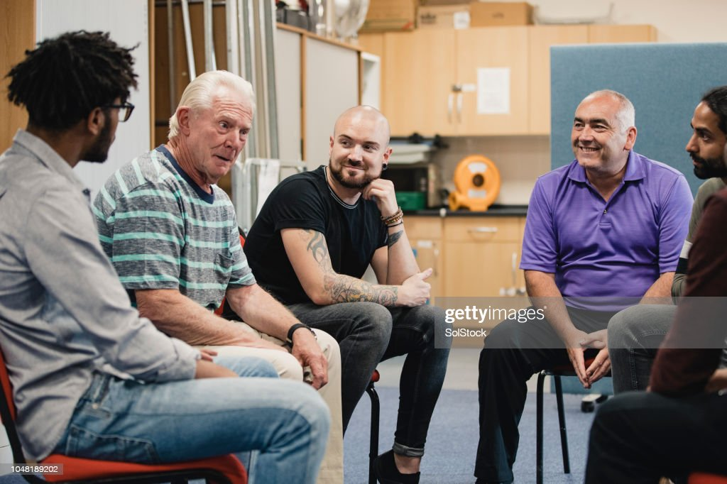 Men in a Support Group : Stock Photo