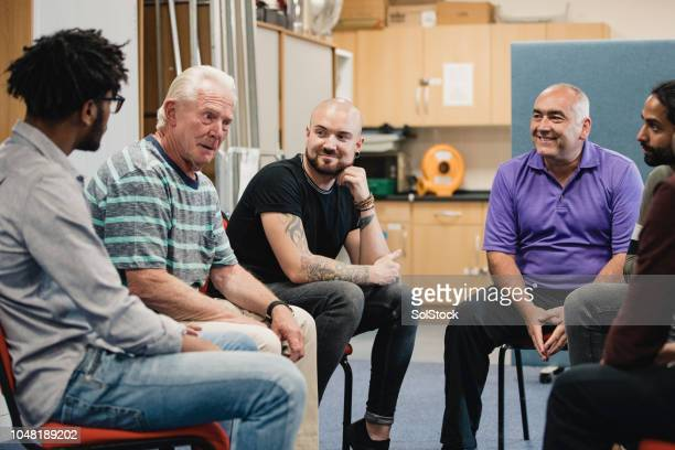 men in a support group - social issues stock pictures, royalty-free photos & images