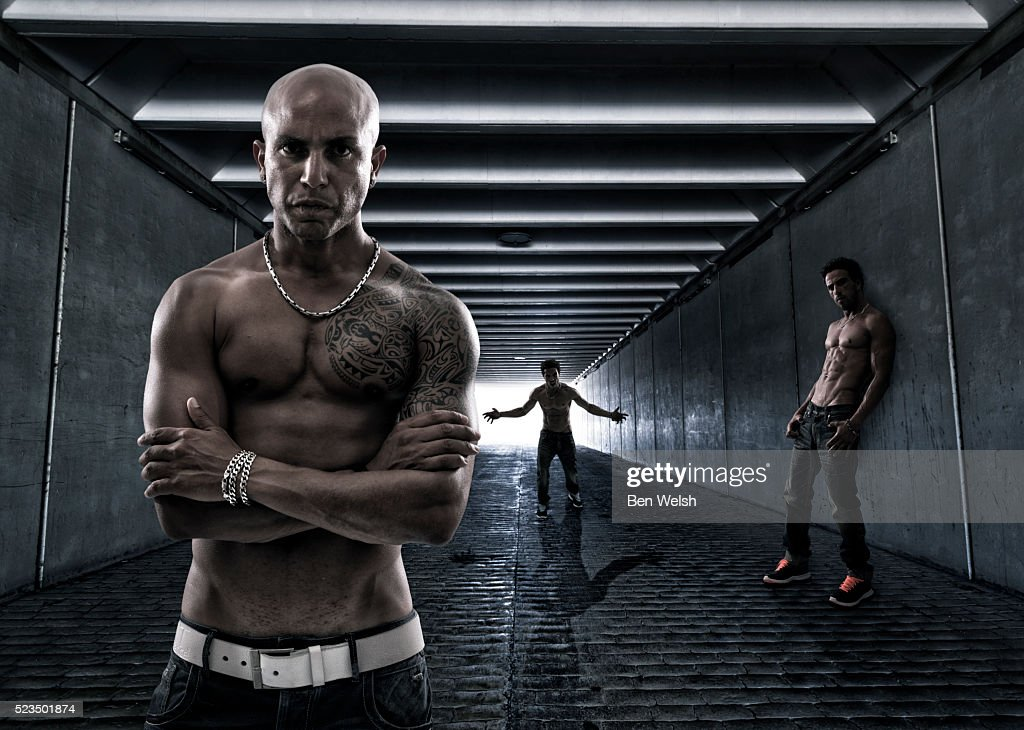Men in a tunnel : Stock Photo