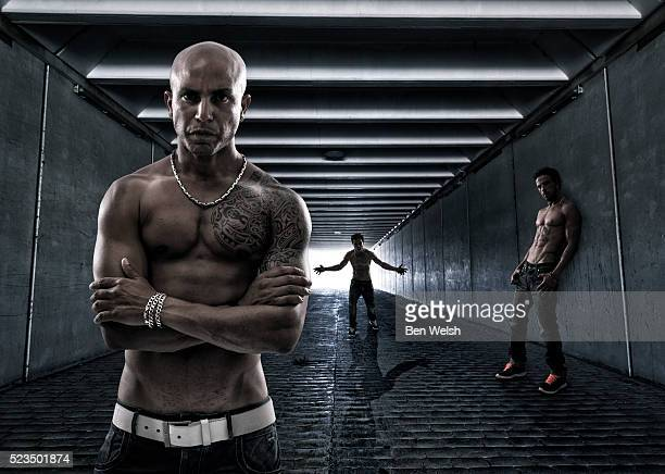 men in a tunnel - black alley stock photos and pictures