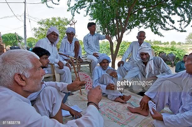 Men in a village discuss the Satrol Khap Panchayat's historic decision of allowing intercaste marriages within 42 villages under its jurisdiction...