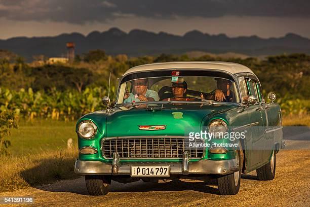 men in a vintage car in the countryside near trinidad - only men stockfoto's en -beelden