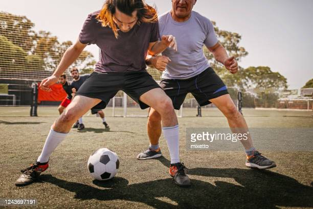 men in action during soccer match on field - shooting at goal stock pictures, royalty-free photos & images