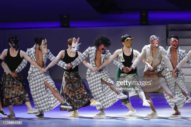 Men in animal masks perform onstage during the PyeongChang 2018 Olympic and Paralympic Winter Games 1st Anniversary Festival In Gangneung on February...