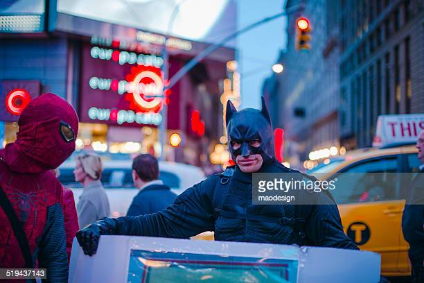 men in batman and spiderman costumes - batman named work stock pictures, royalty-free photos & images