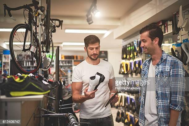 Men in bicycle store