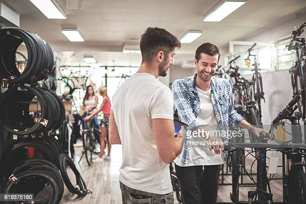 Men in bicycle store