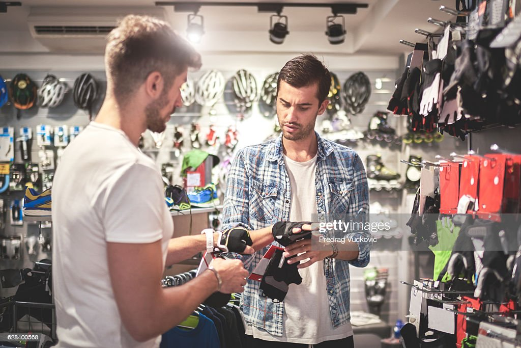 Men in bicycle store : Stock Photo