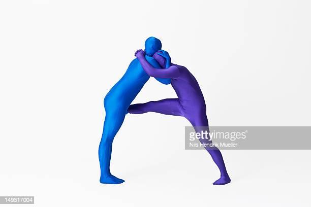 men in bodysuits making the letter a - lettera a foto e immagini stock
