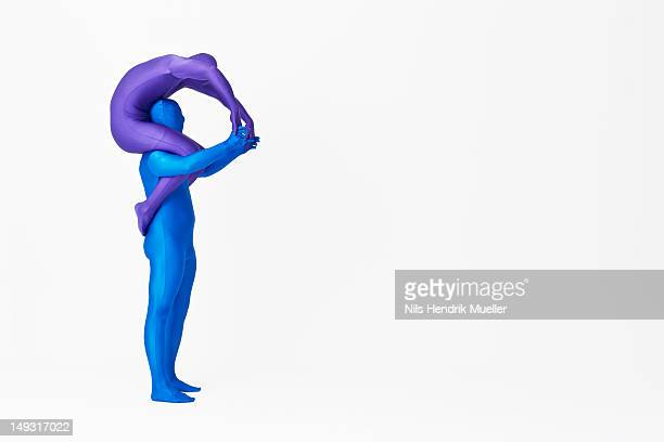 men in bodysuits making the letter p - letter p stock pictures, royalty-free photos & images