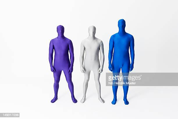men in bodysuits standing together - bodysuit stock pictures, royalty-free photos & images
