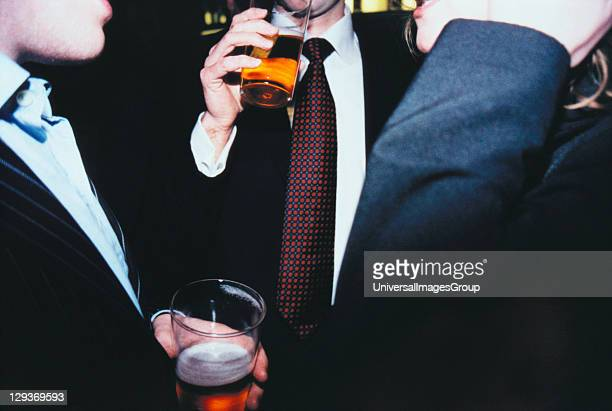 Men in Business Attire Drinking Pints of Beer