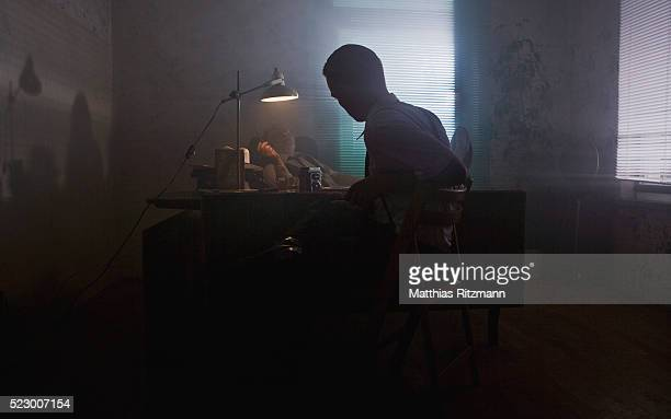 men in dark office meeting - film noir style stock pictures, royalty-free photos & images
