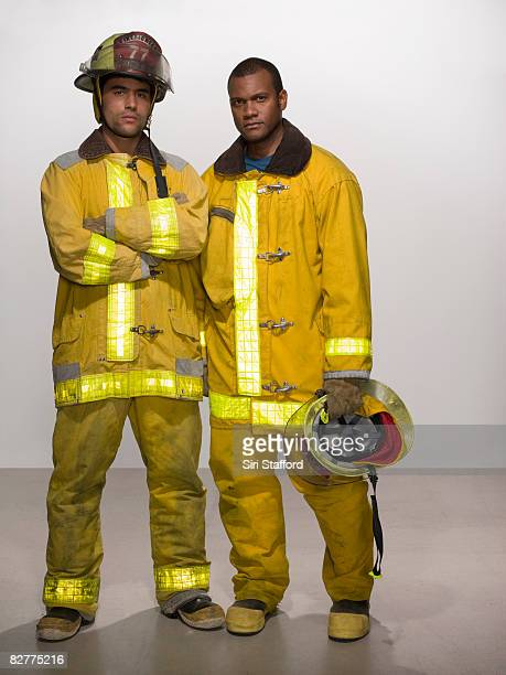 men in firefighting suits