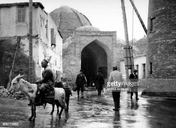 Men in front of a caravansary at Bukhara in Uzbekistan Soviet Union 1970s