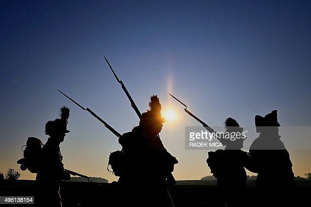 Men in historical uniforms of the Napoleon's army attend a reenactment maneuver in sunset on October 31 2015 near Drevohostice during a socalled All...