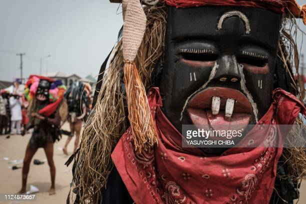 Men in mask perform during a rally of Rivers state's incumbent Governor Ezenwo Nyesom Wike in Port Harcourt Southern Nigeria on February 13 2019...