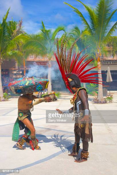 Men in Mayan costume on Mahahual plaza