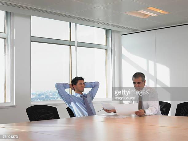 men in meeting room - arrogance stock pictures, royalty-free photos & images