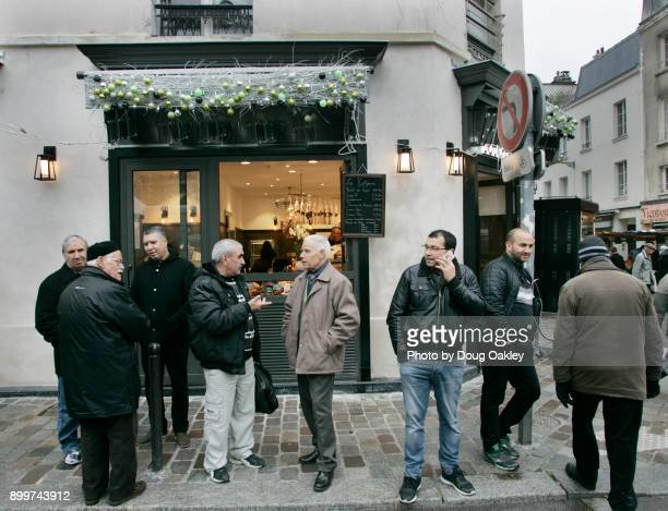 Men in Paris Socializing on Sidewalk on Christmas Eve