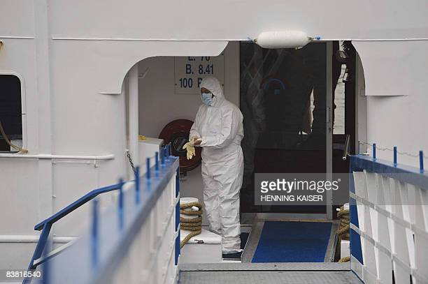 Men in protective clothes work on the disinfection of the pleasure boat Lady Anne where the Norovirus broke out on the Rhine river in Boppard western...
