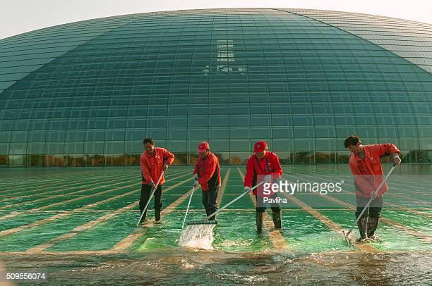 men in red working beijing opera house, beijing,china - pavliha stock photos and pictures