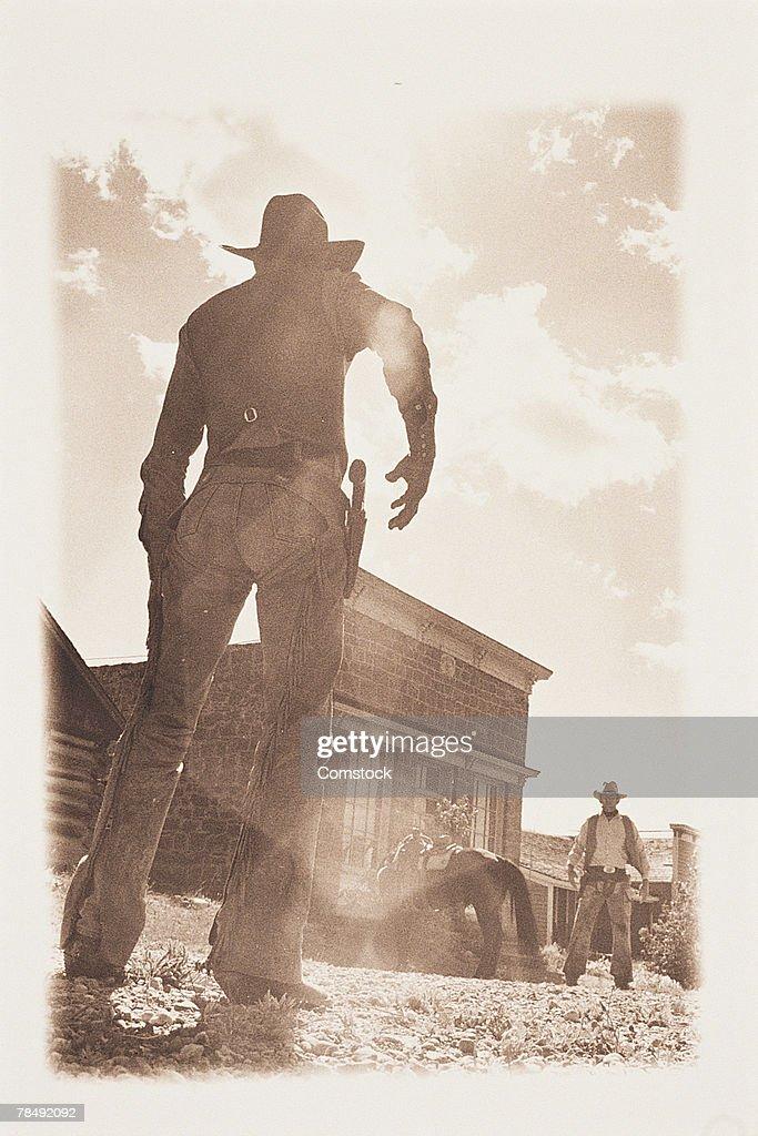 Men in reenactment of Western shootout : Stock Photo