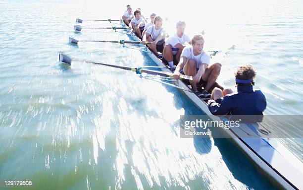 Men in row boat oaring