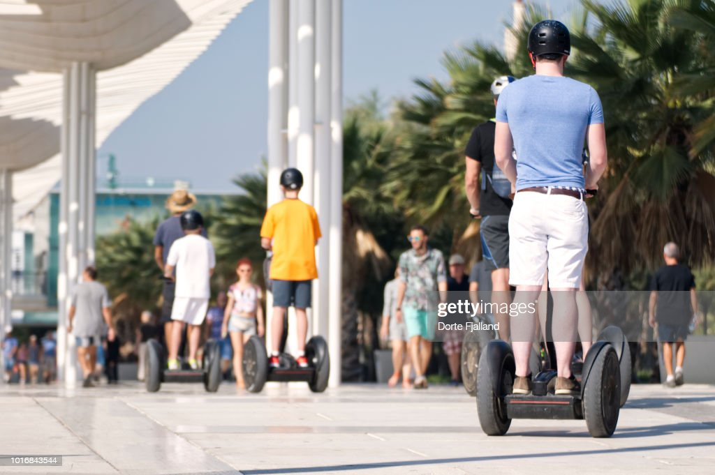Men in Summer clothes and helmets on segway on a sunny day : Foto de stock