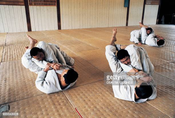 Men in the gym doing judo exercises Japan